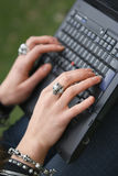Female Hands typing on Laptop Royalty Free Stock Photo