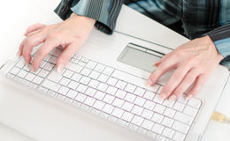 Female hands typing on a laptop computer keyboard Royalty Free Stock Images