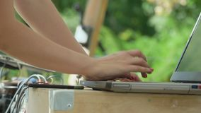Female hands typing on laptop stock video footage
