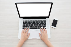 Female hands typing on a laptop keyboard Stock Images