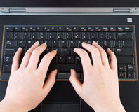 Female hands typing on laptop keyboard Stock Photography