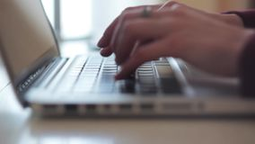 Female hands typing on a laptop keyboard stock video