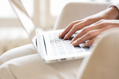 Female hands typing on a laptop keyboard Stock Photography