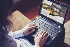 Female hands typing on a laptop keyboard. Royalty Free Stock Images
