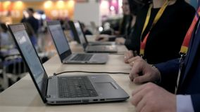 Female hands typing on laptop. Line of office workers hands typing on laptops computers. Big event. Female hands typing on laptop. Line of office workers hands stock video footage