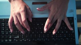 Female hands typing on the laptop, top view. Keyboard typing by hand. Office work. stock video
