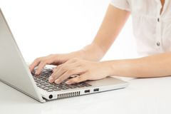 Female hands typing on laptop. White background Royalty Free Stock Images