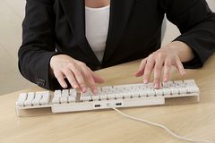 Female hands typing on laptop Royalty Free Stock Photos