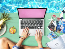 Female Hands Typing Macbook Poolside Concept royalty free stock photos