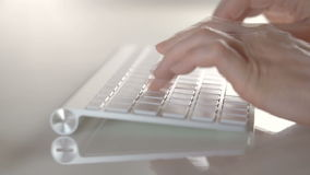 Female hands typing on the silver laptop keyboard. Close view. Woman hands typing on the silver laptop keyboard. Close view Full HD video stock video