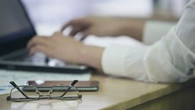Female hands typing text on laptop, busy office employee working on project. Stock footage stock footage