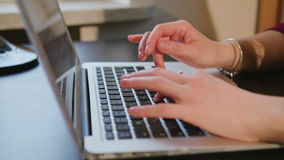 Female Hands Typing Text on Laptop Keyboard. Dolly shoot female hands typing text on laptop keyboard stock video