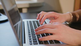 Female Hands Typing Text on Laptop Keyboard. Dolly shoot female hands typing text on laptop keyboard stock video footage