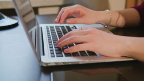 Female Hands Typing Text on Laptop Keyboard. Dolly shoot female hands typing text on laptop keyboard stock footage