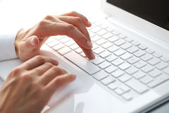 Female hands typing on a white computer Stock Photos