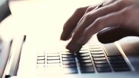 Female hands using computer laptop. Vintage filter. Female hands professionally typing text on a laptop computer. Macro fingers quickly hit the keys of the stock footage