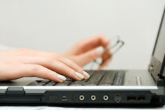 Female hands using laptop Royalty Free Stock Photo