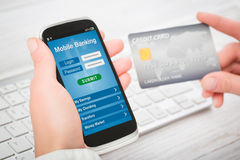 Female hands using mobile banking on smart phone. Royalty Free Stock Images