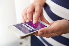 Female hands using mobile banking. On smartphone royalty free stock photography