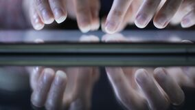 Female hands using modern application on tablet, typing message, zooming files. Stock footage stock video footage