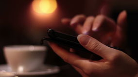 Female hands using a smartphone in the cafe and the waitress brings the order. Close-up full hd stock footage