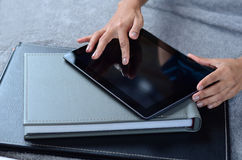 Female hands using tablet PC. Beautiful female hands using tablet PC Stock Image
