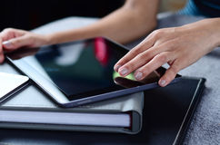 Female hands using tablet PC. Beautiful female hands using tablet PC Royalty Free Stock Image