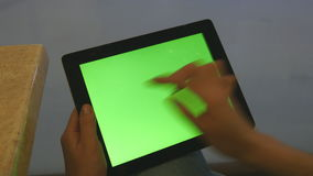 Female hands using tablet pc with green screen in shopping mall. Female hands using tablet pc with green screen in shopping mall stock video footage