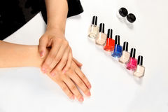 Female hands and varnish vials Stock Photography