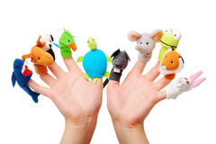 Female hands wearing 10 finger puppets stock photo