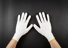 Female hands with white protective gloves Stock Photo