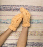 Female hands in woolen knitted mittens Stock Images