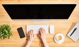 Female hands working on modern desktop computer stock photo