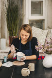 Female hands working on mug Stock Images