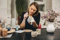 Female hands working on mug Stock Photography
