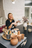 Female hands working on mug Royalty Free Stock Photography