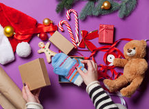 Female hands wrapping a gift Royalty Free Stock Image