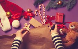 Female hands wrapping a gift Stock Photography