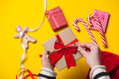 Female hands wrapping a gift Stock Images