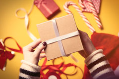 Female hands wrapping a gift Stock Image