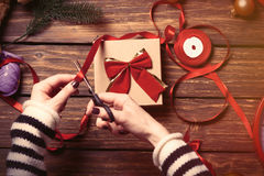 Female hands wrapping a gift royalty free stock photography
