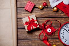 Female hands wrapping gifts for Holidays on wooden table. Above view Royalty Free Stock Images