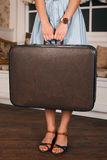 Female hands with wrist watch hold a suitcase. Stock Photography