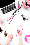 The female hands writing against fashion woman objects Stock Photos