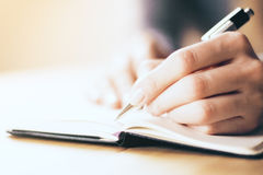 Female hands writing in notebook Royalty Free Stock Photos