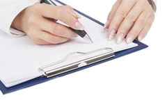 Female hands writing on paper sheet Stock Image