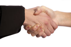 Female handshake. Two female hands shaking to close an agreed contract deal Royalty Free Stock Photos