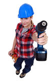 A female handyman. With a drill Stock Images