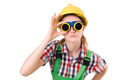 Female handyman in overalls isolated on the white Royalty Free Stock Photo