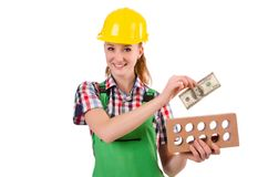 Female handyman in overalls isolated on the white Stock Photography